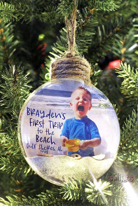 baby's christmas ornament trip at the beach